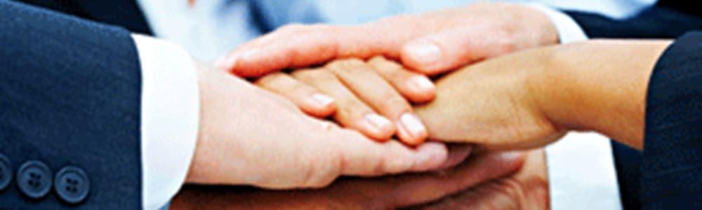 podanie rúk vo význame spojenie spoločností EDITEL a EDISON